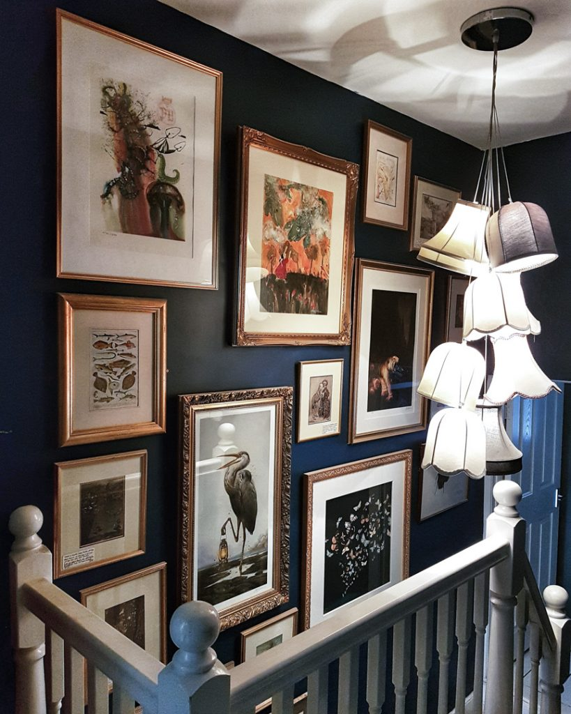 navy blue gallery wall with blue frames