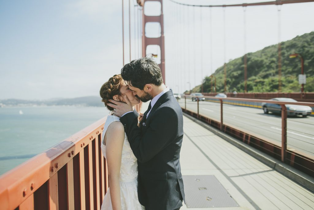 Couple kissing on Golden Gate Bridge