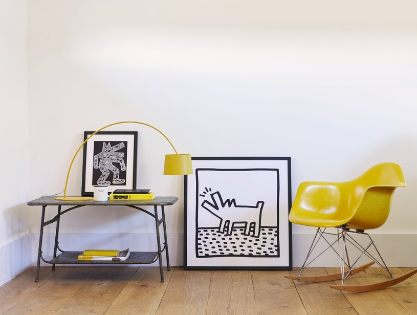 Keith Haring graphic cartoon 80s dog barking prints with a yellow rocking chair, great coffee table and yellow lamp.