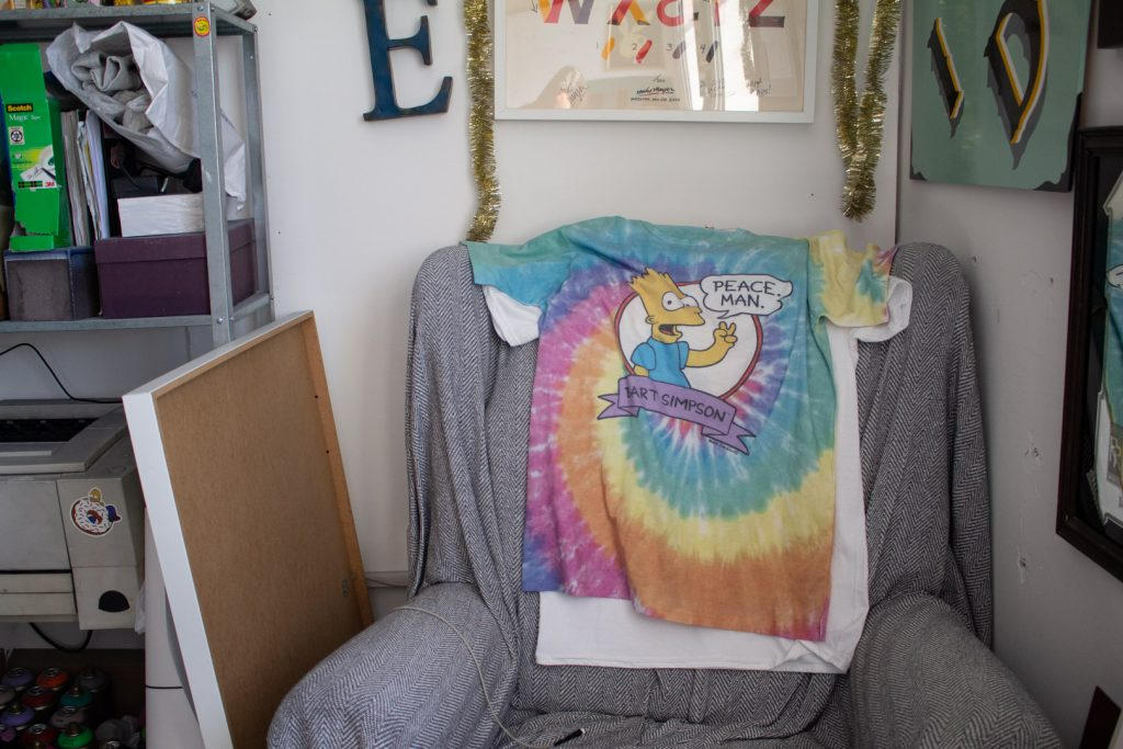 Simpsons T-shirt on a chair