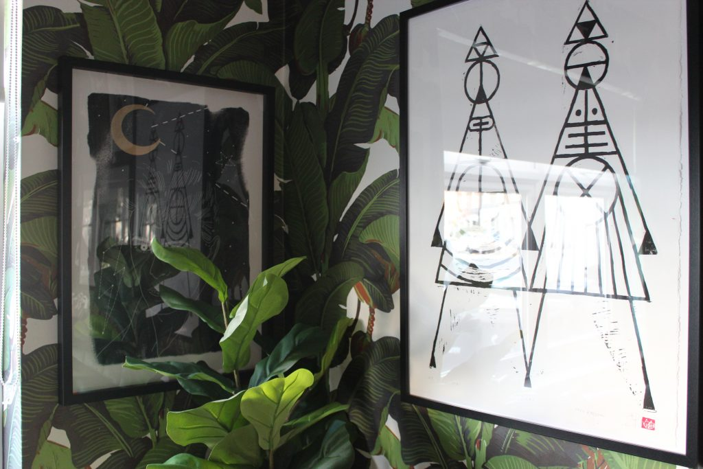 bowie and abstract monochrome prints on a banana leaf wallpaper