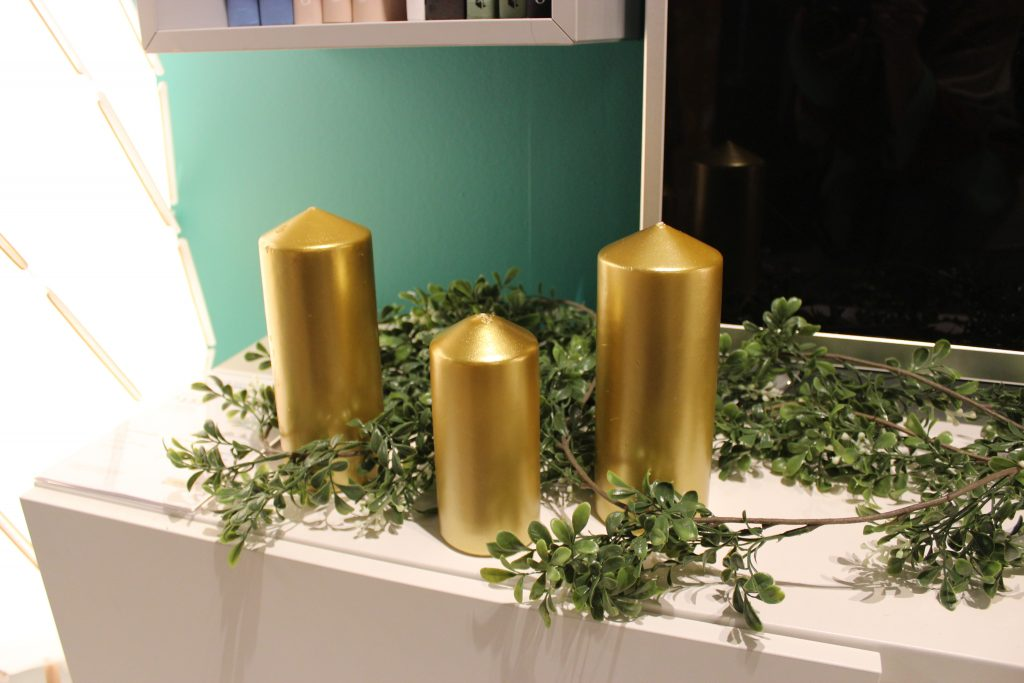 gold candles in a festive garland