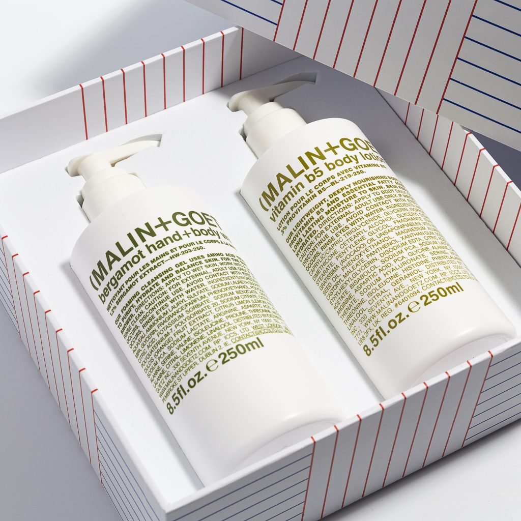 body lotion and shower gel in white bottles in a white box