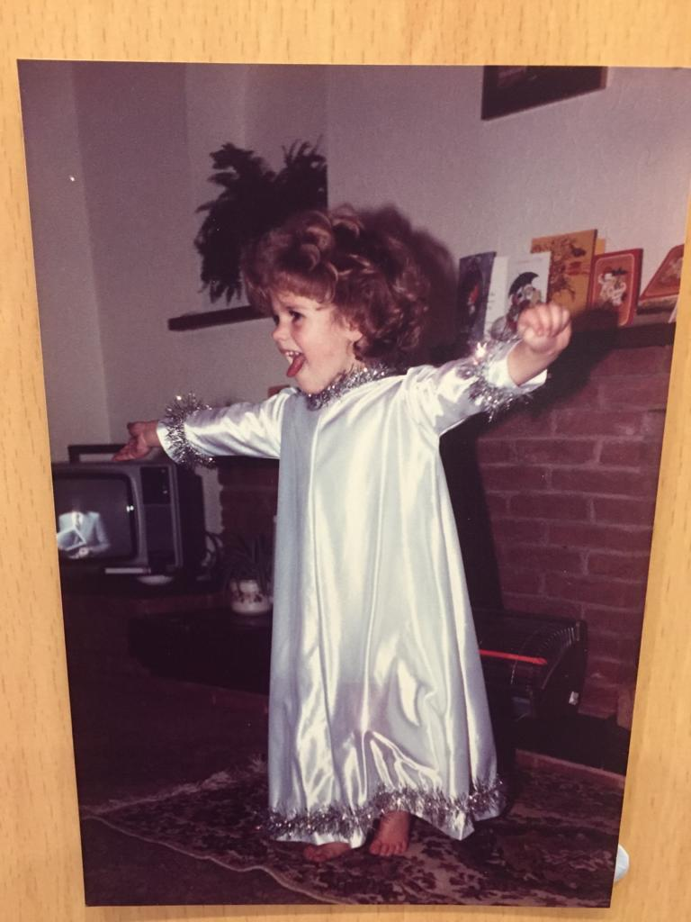 a photograph of a small child dressed as an angel