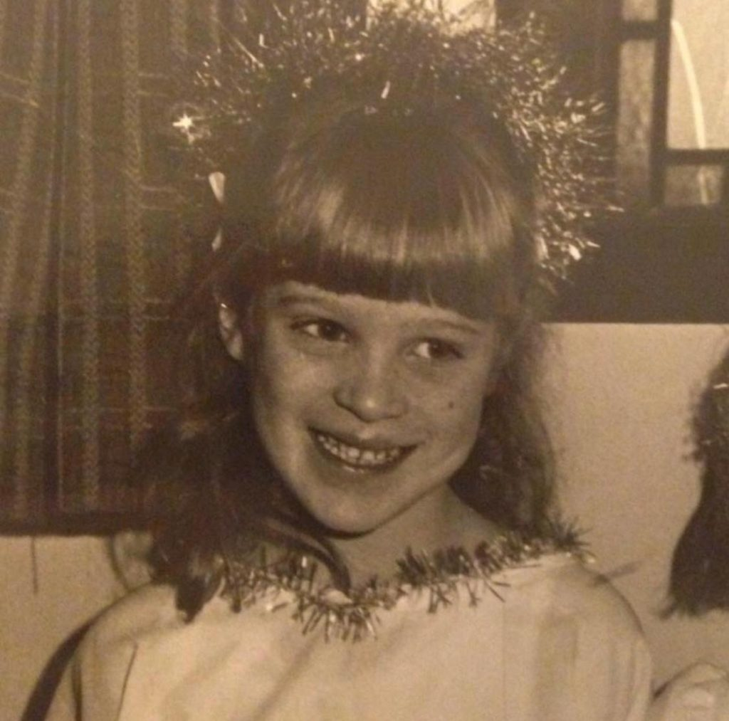 an old photograph of a child dressed as an angel
