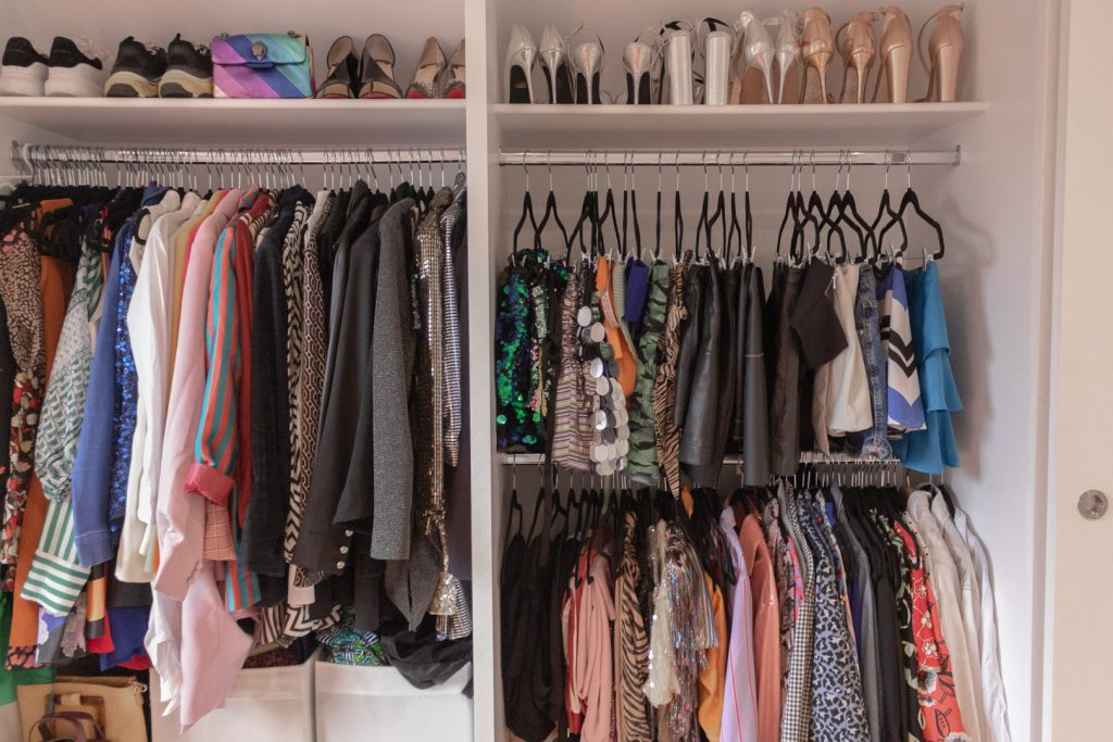 Image shows a wardrobe full of sparkly, fancy, joyful clothes