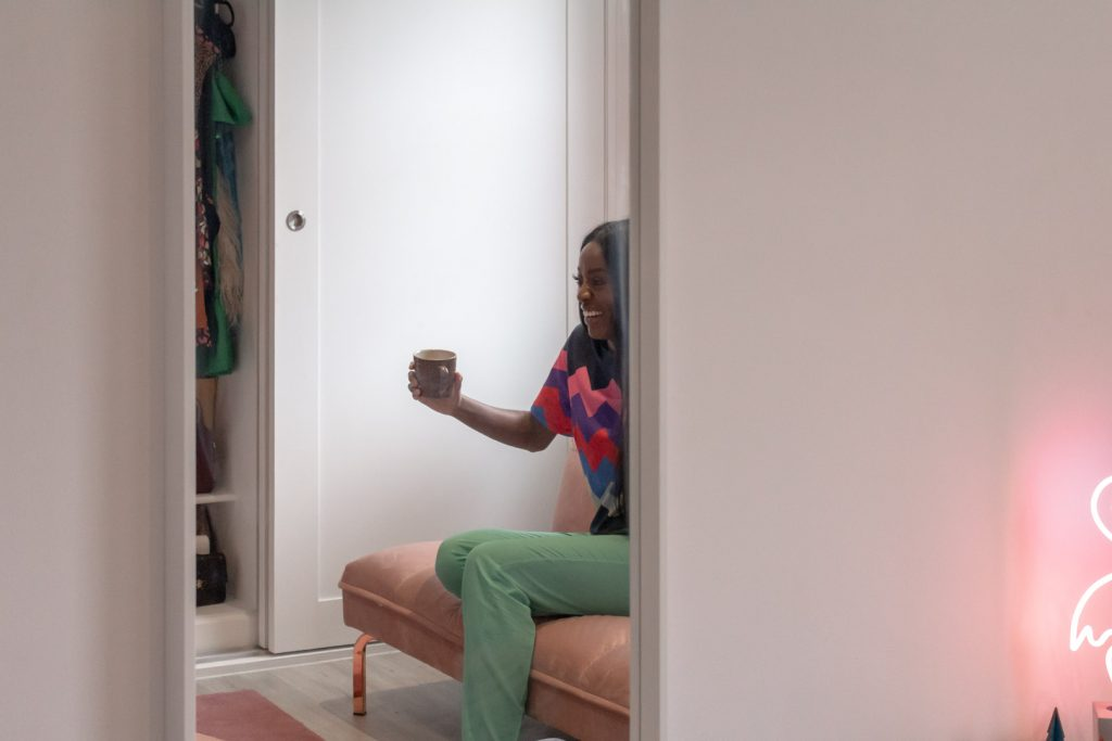 Image shows AJ's reflection in the mirror