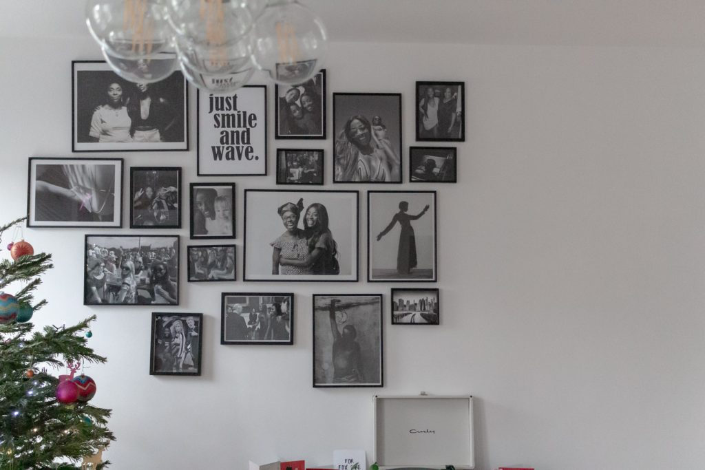 a collection of black and white photographs on a white wall