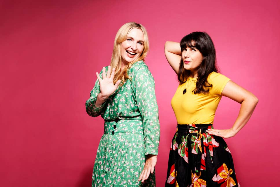 Two women. One blonde in a green dress. One brunette in a yellow top and floral skirt
