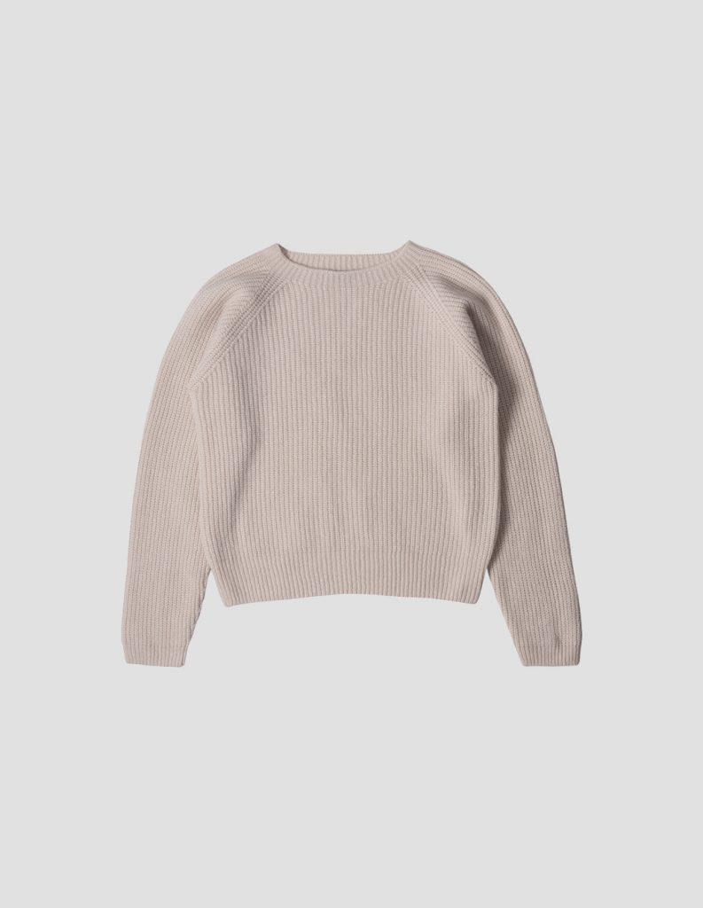 beige jumper on a grey background