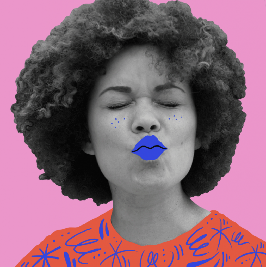 a woman kisses the camera. She is in black and white but her lips are blue and the background is pink