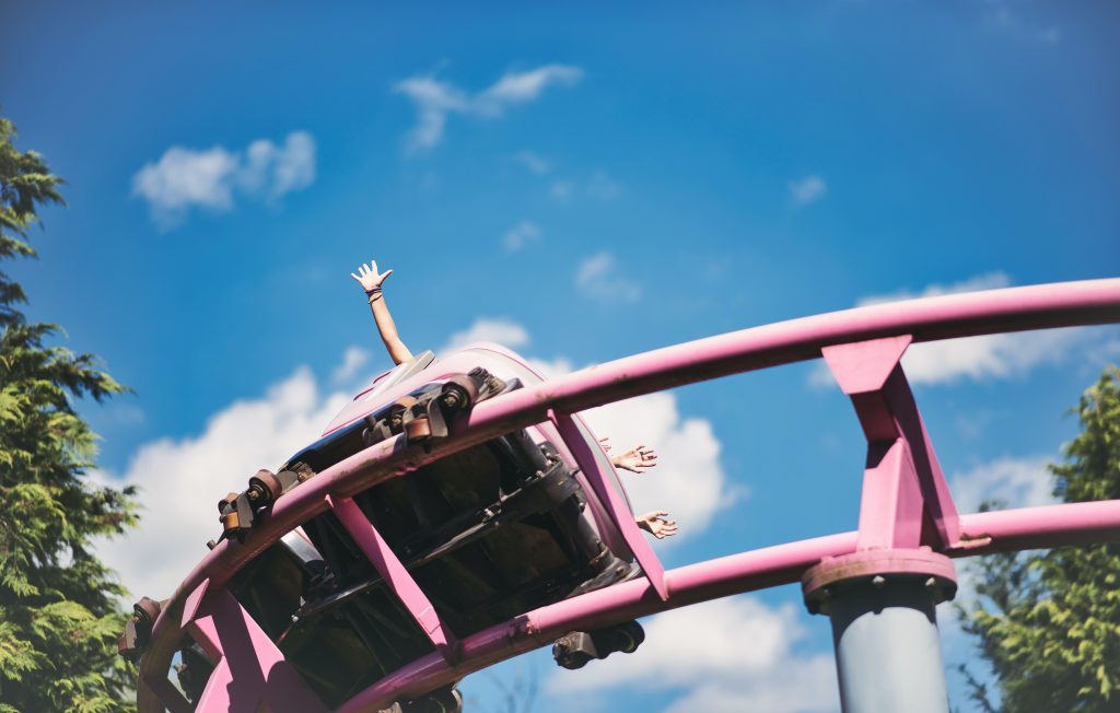 A pink rollercoaster shot from below